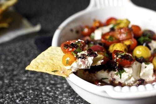 Cheesy, veggie-packed, and filled with savory goodness, we love the idea of covering an entire flatbread with this yummy dip.