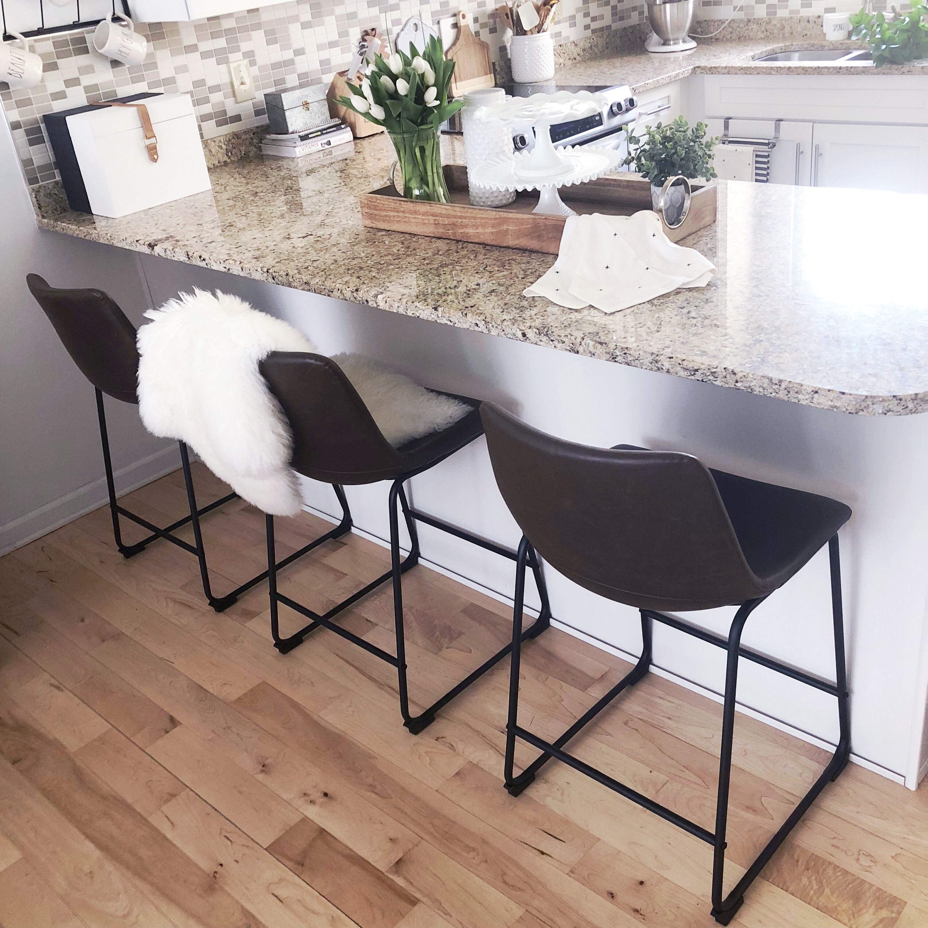 Brown And Black Faux Leather Target Counter Stools With A Sheepskin Throw Grani Kitchen Interior Design Modern Modern Kitchen Interiors Interior Design Kitchen