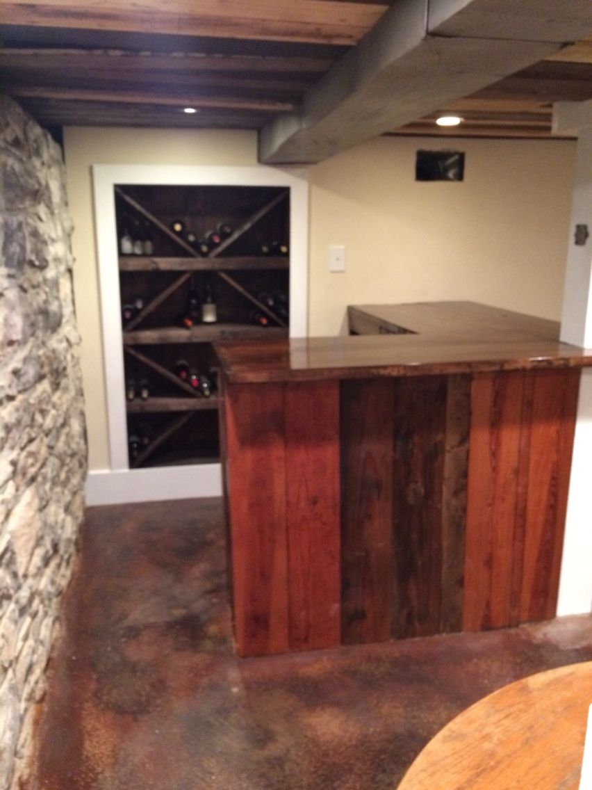 Basement Stack stone foundation. Stained concrete,recessed