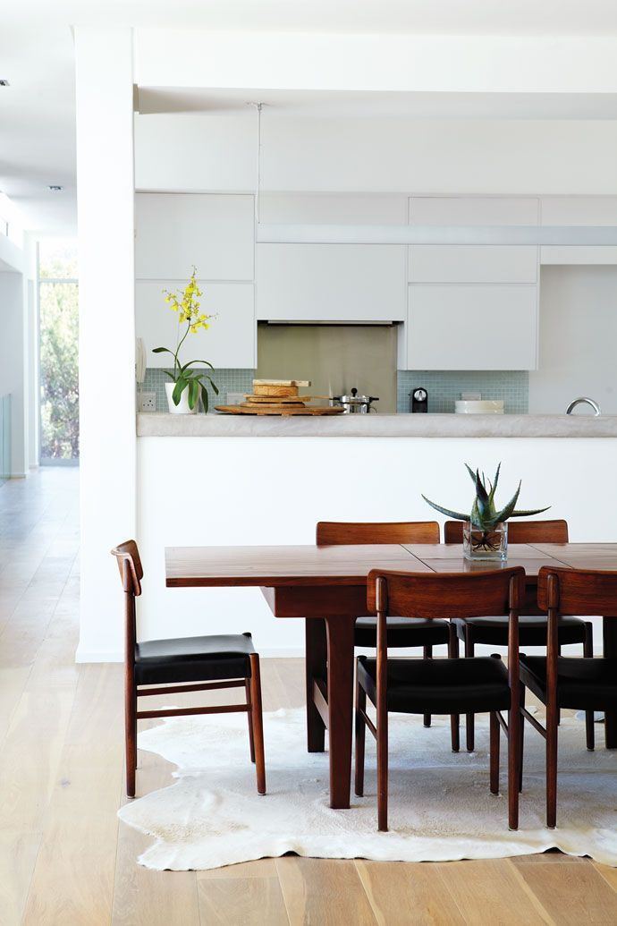 We love the sleek cool look of this lounge and open-plan kitchen.