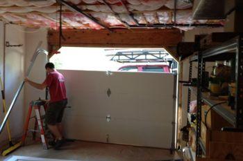 Garage Door Problems Got You Stuck Here S How To Get Out Garage Door Installation Garage Door Problems Garage Doors