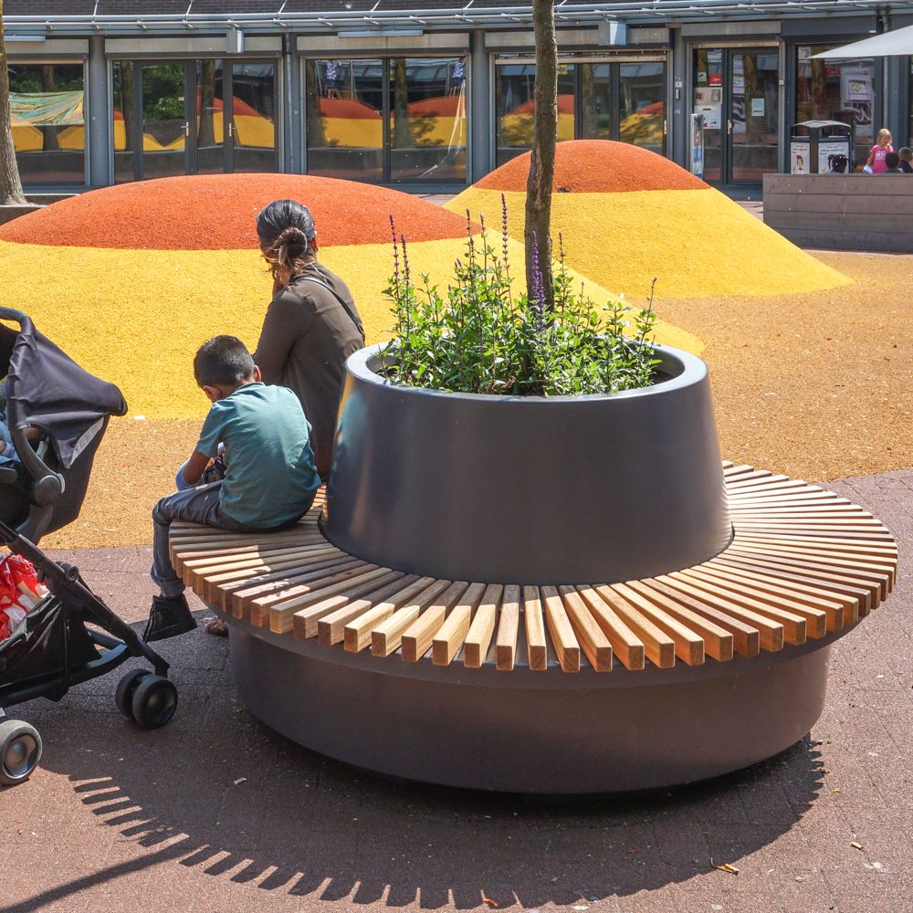 Green Circular Benches Are Planter Elements That Offer Plenty Of Seating Streetlife Recommends Equipping The Tree Planter With Th Circular Bench Tree Planters
