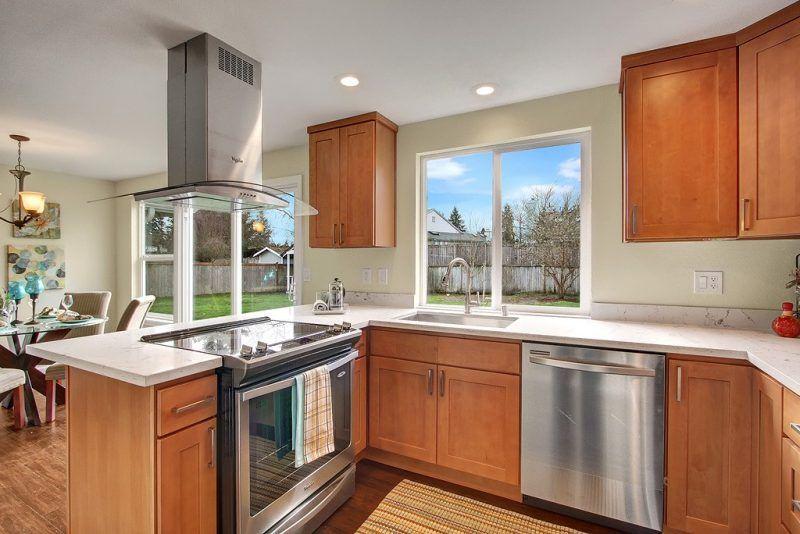 Quartz Countertops With Maple Cabinets
