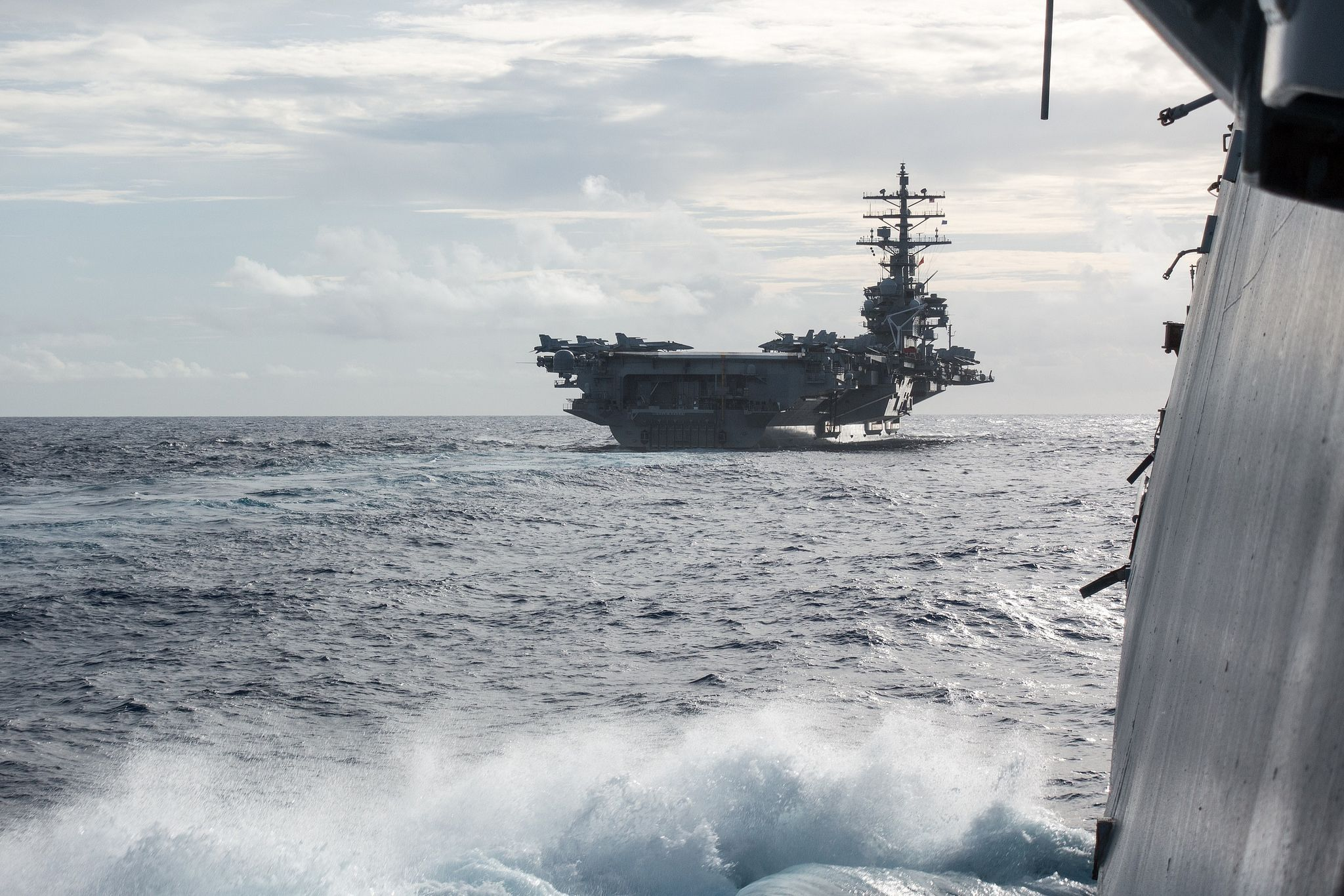 https://flic.kr/p/MV6SEp | 161002-N-GY813-002 | PHILIPPINE SEA (Oct. 2, 2016) The Nimitz-class aircraft carrier USS Ronald Reagan (CVN76) steams ahead of the Arleigh Burke-class guided-missile destroyer USS Stethem (DDG 63). Stethem is on patrol with Carrier Strike Group Five (CSG 5) in the Philippine Sea supporting security and stability in the Indo-Asia-Pacific region. (U.S. Navy photo by Lt. Cmdr. Tyrone Pham/ Released)
