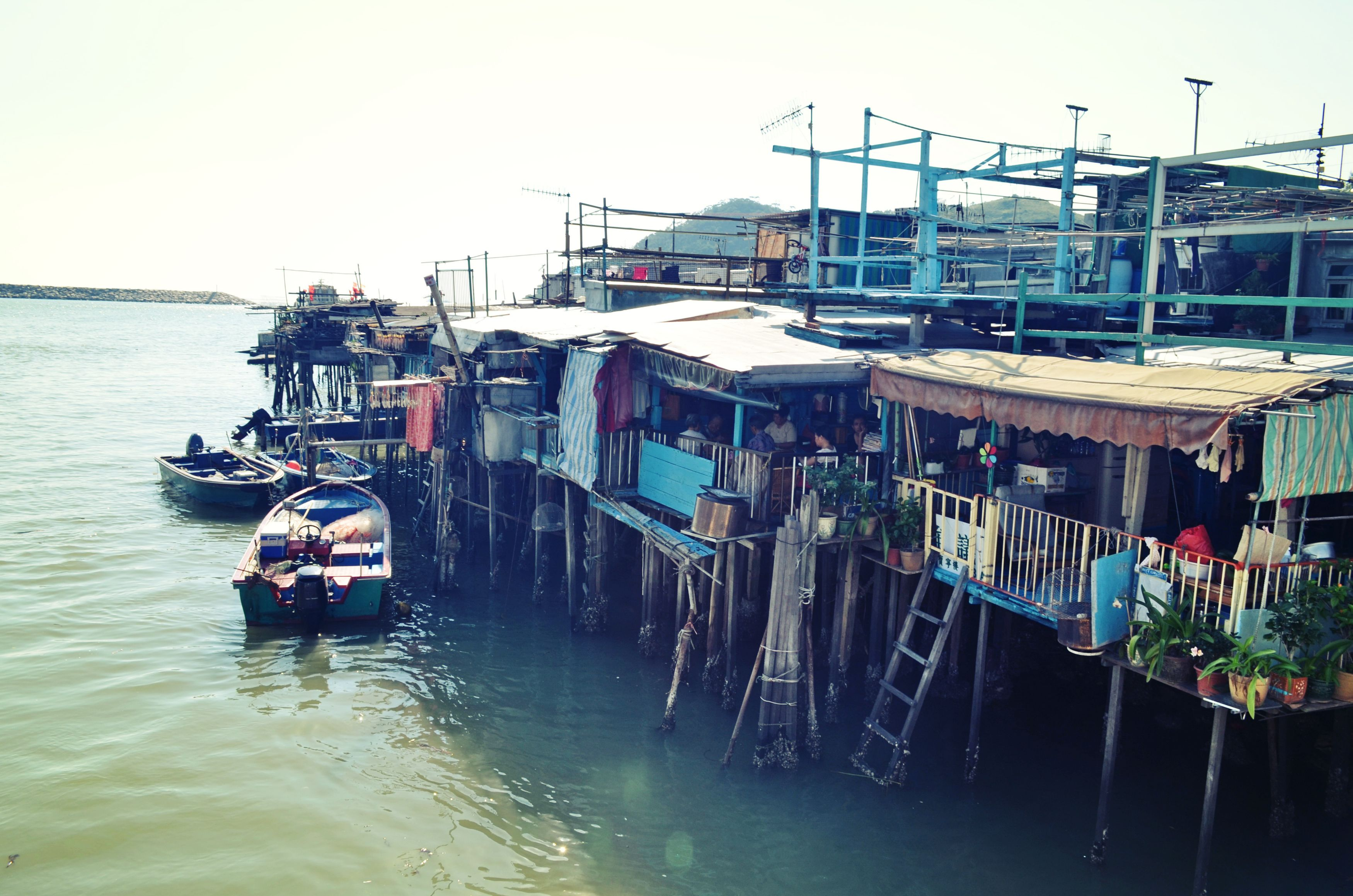 tai o. stilt houses. boat.