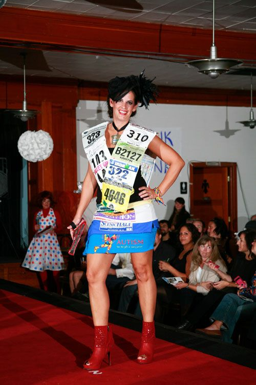 """""""The Finish Line"""" by Kristen Ludwig, model Stacy Mattis. Made from race bib numbers, race t-shirts, Stinger/Gu/Shot Block packets, race medals, tennis ball canisters, swim bag mesh and shoe strings. Featured in the 2012 Junk2Funk Eco-Fashion show, a benefit of the Kootenai Environmental Alliance that showcases the runway outfits made from recycled materials by local artists."""