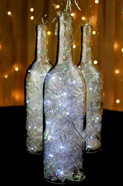 Clear Wine Bottles Filled With Holographic Shred And Battery Operated Fairy Lights