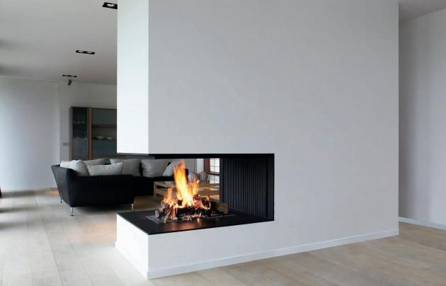 Open fireplace faces several living spaces