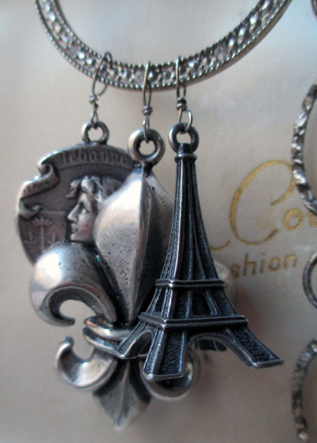 cote d'azur - assemblage double-wrap necklace with eiffel tower, fleur de lis, joan of arc and turquoise by the french circus. $191.00, via Etsy.