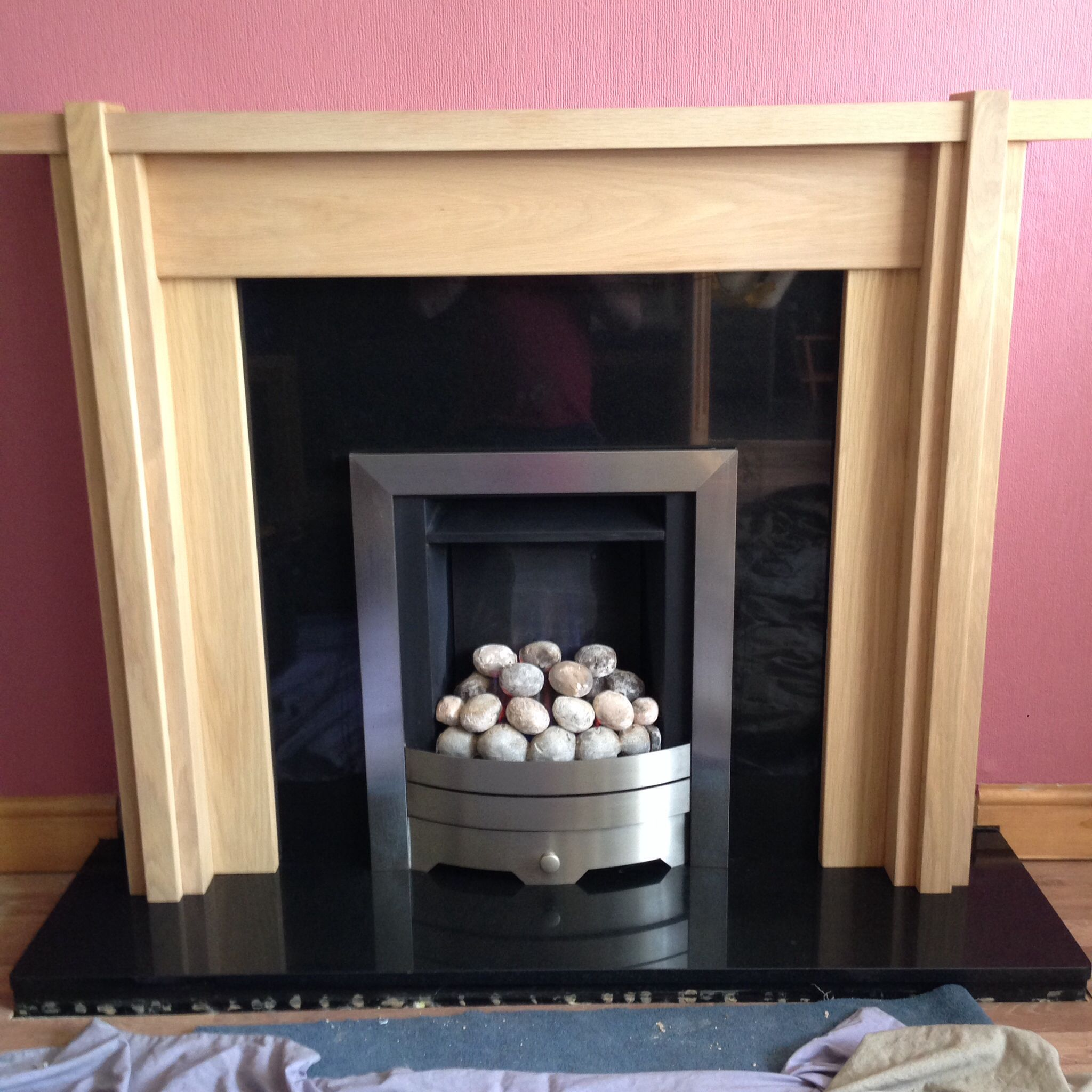 Solid oak mantel with black granite hearth and slimline legend gas ...