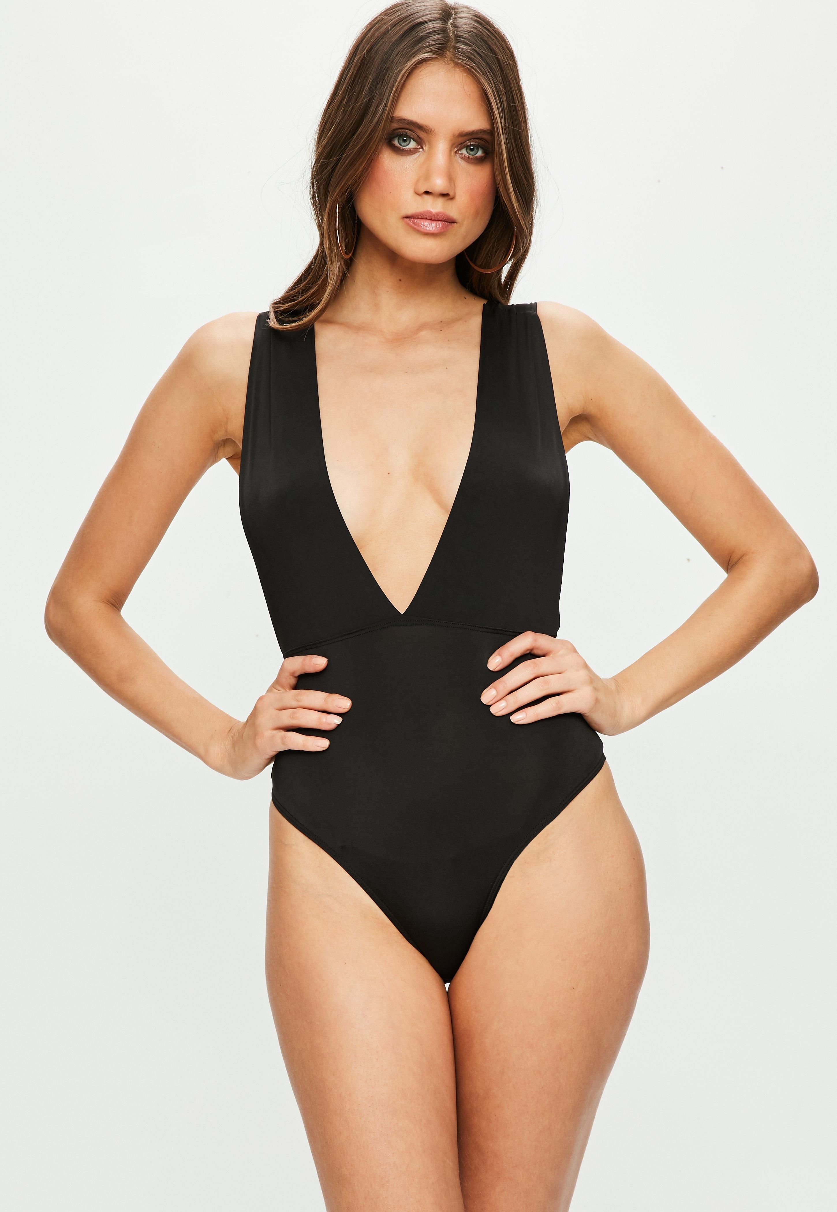 69e18b3d962 Black bodysuit featuring an extreme plunge neckline