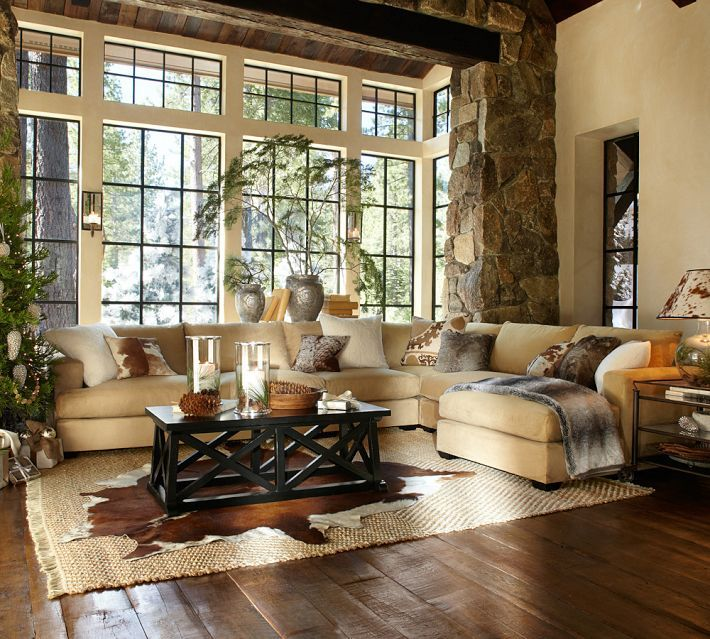 Pottery Barn Living Room With Carpet And Decorative Plant: Stacked Stone Supporting Beefy Beam, Steel Frame Window