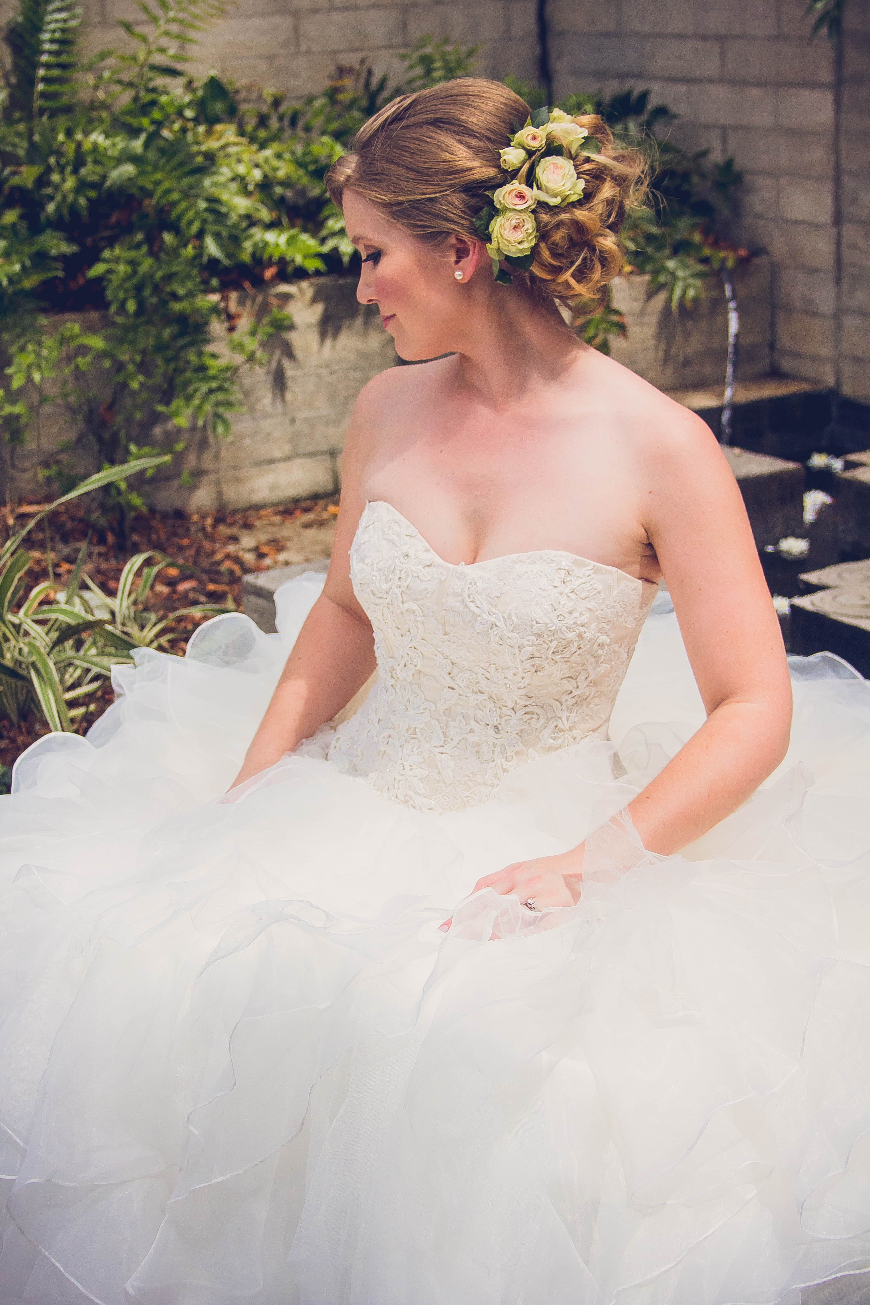 Updo With Rose Floral Accent Beautiful Wedding Hair Wedding Hairstyles Wedding Hair And Makeup