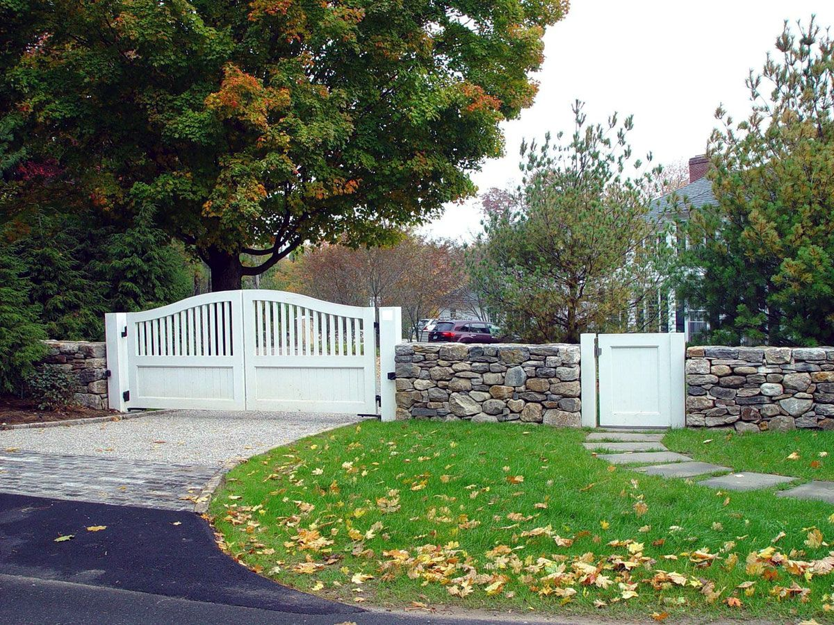 A classic white composite material driveway entrance gate with matching pedestrian gate gates by tri