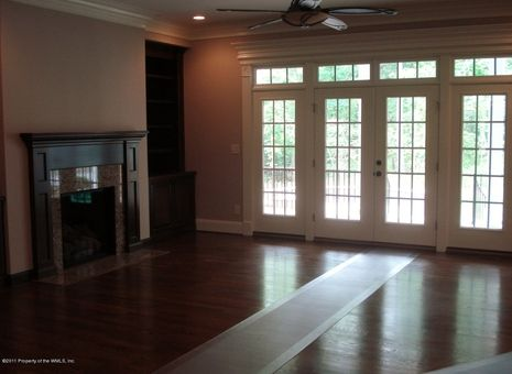 Bank of french doors with transom windows.