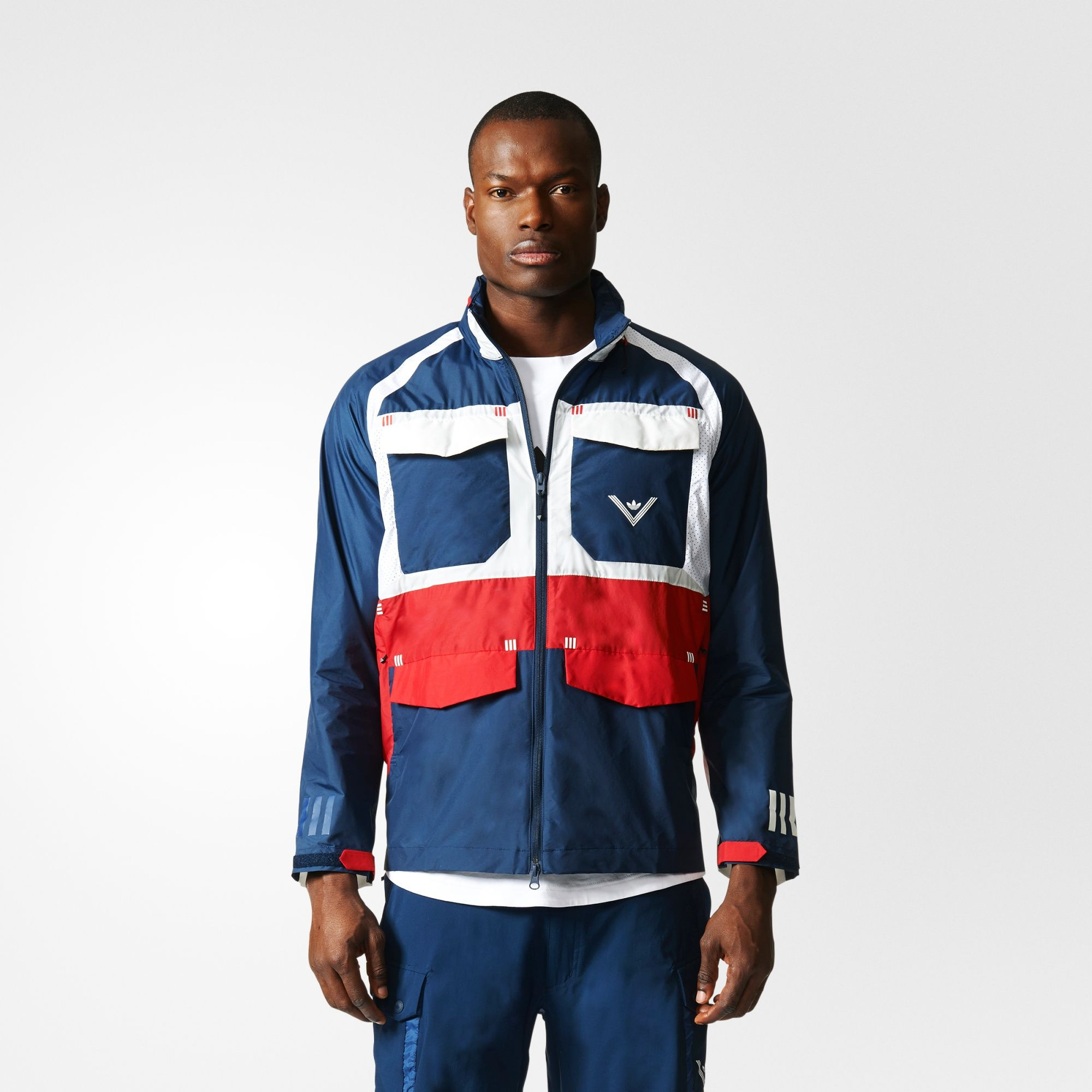 Technical outdoor wear and modern design language have inspired White Mountaineering since its inception in 2006. The collaboration between the Tokyo-based brand and adidas Originals elevates archival pieces with hiking and outdoor elements. This men's windbreaker takes inspiration from the urban landscape for a look that's technical but stylish enough for city streets. It's made in plain weave fabric and accented with contrast panels and utility pockets. The cuffs feature reflect...