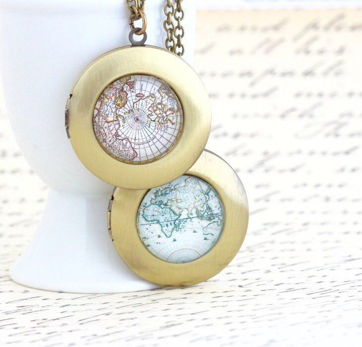 World map locket necklace locket necklace glass domes and map this unique round brass map locket necklace boasts a vintage map print below a glass dome the locket opens so that you can insert a photo inside gumiabroncs Gallery