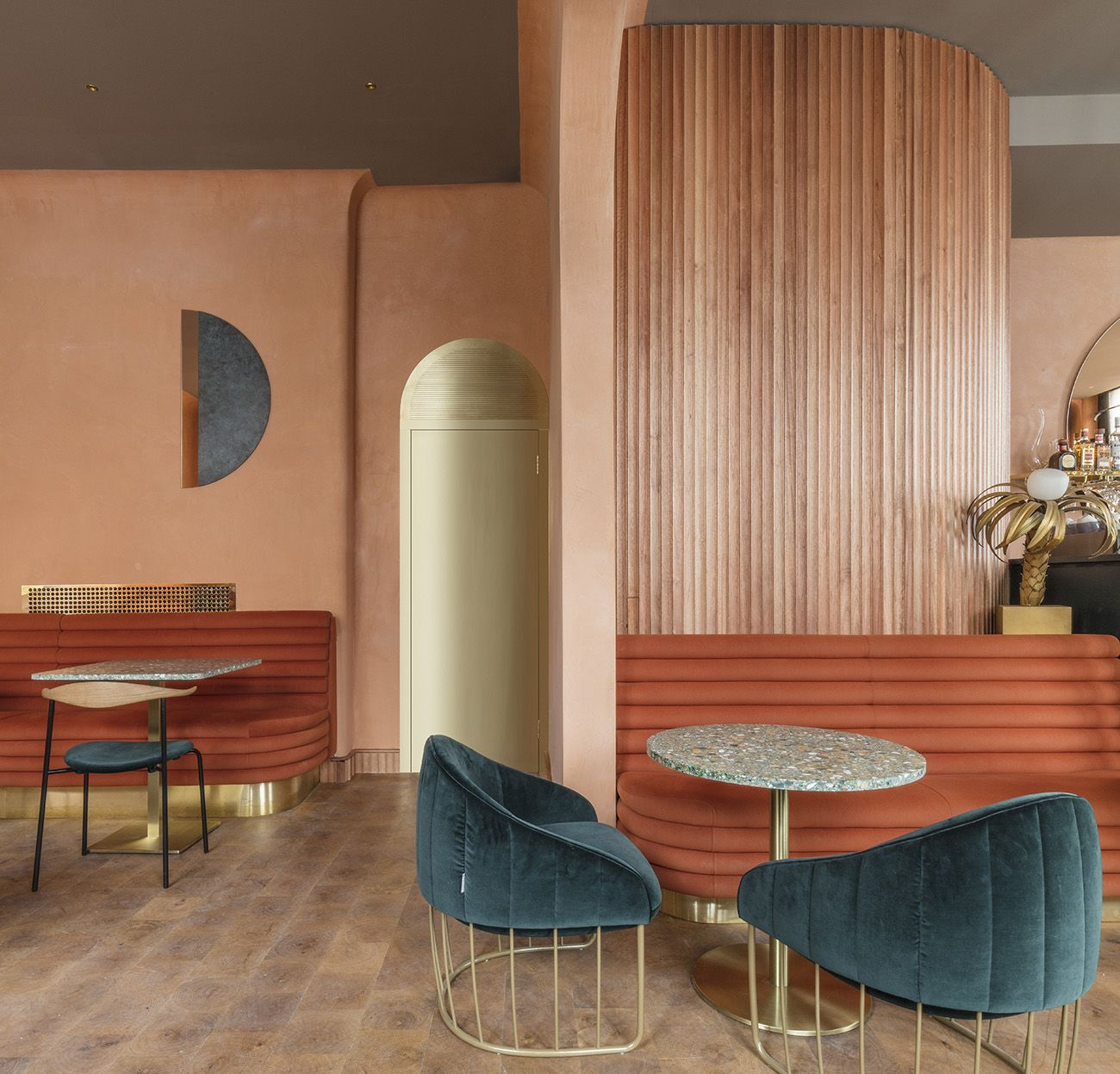 Terracotta walls, teal armchairs, brass arches, terrazzo tables and more at Omar's Place in London