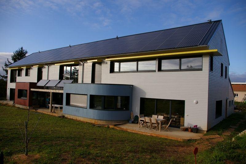 Maison ossature bois bbc - bardage composite fundermax, enduit sur - Exemple Devis Construction Maison