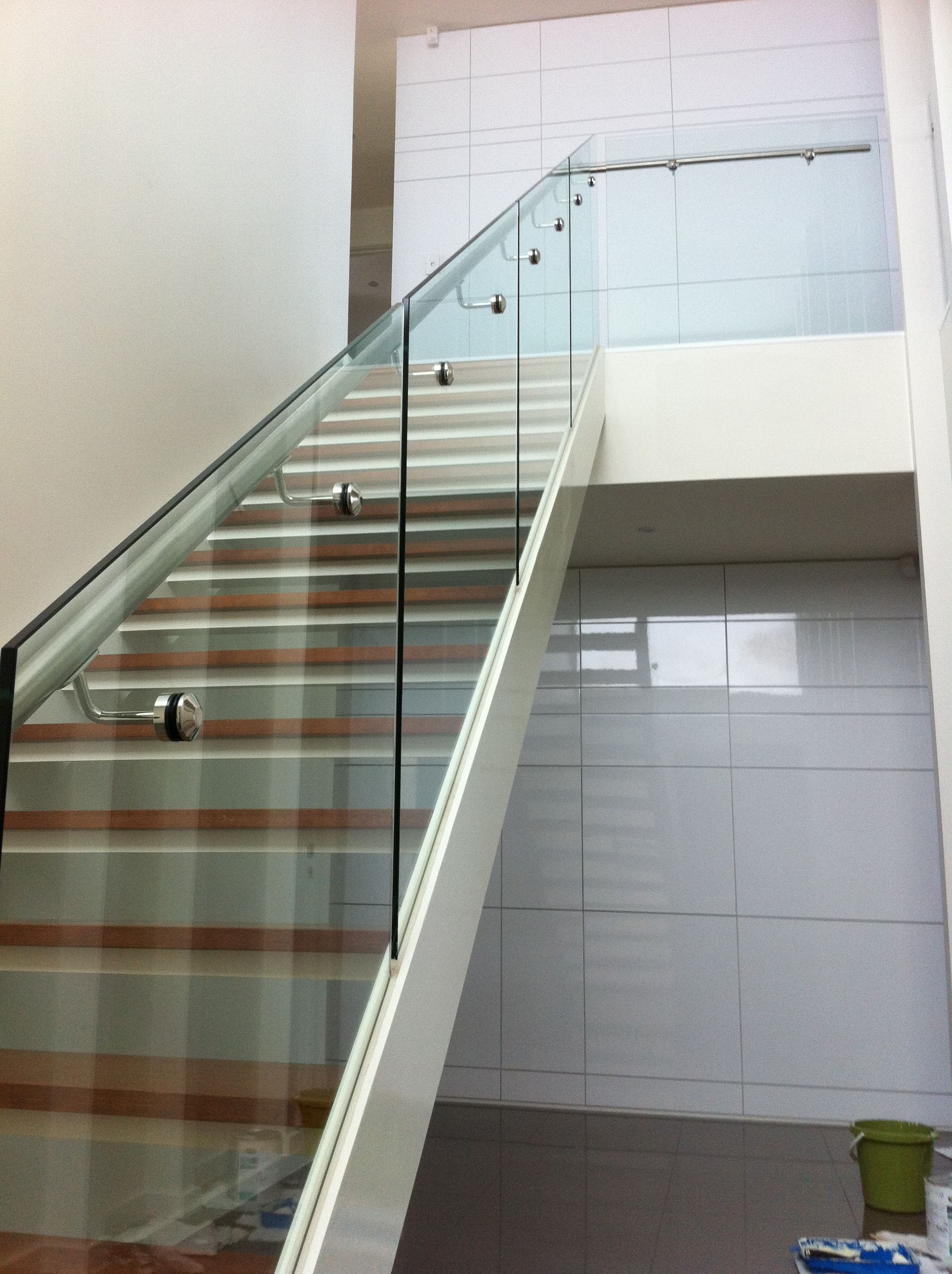 Glass Balustrade For Stairs With Side Mount Stainless Steel Handrail.