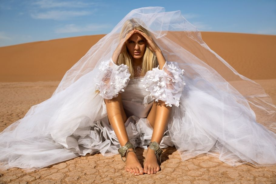 Girl Sitting In Wedding Dress The Desert Caitlin Hartley Of It Weddings