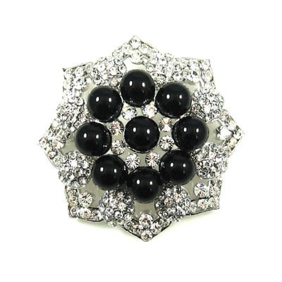 Black and silver brooch