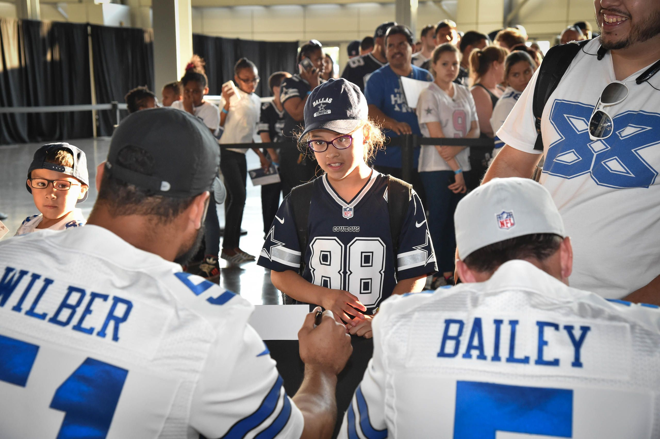 Kyle Wilber and Dan Bailey sign autographs during the draft party.