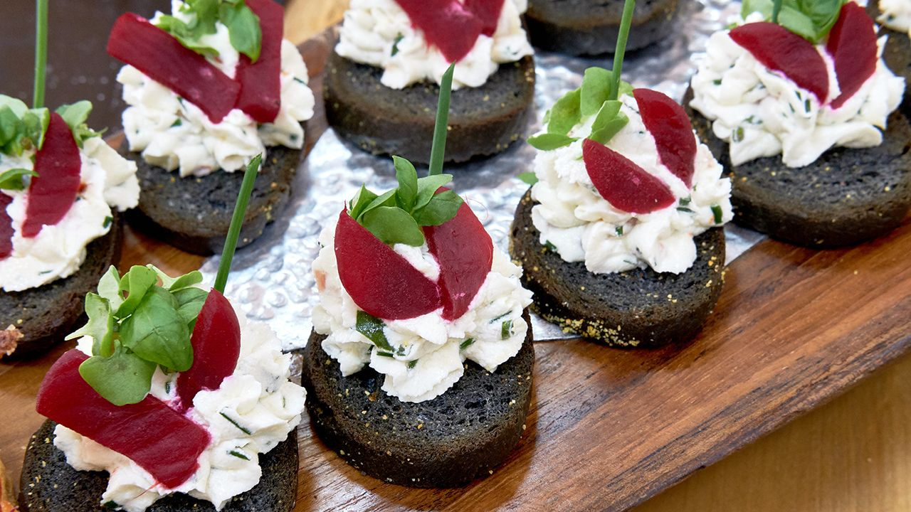 Canapés Show Charcoal Baguette Beet And Goat Cheese Canapés
