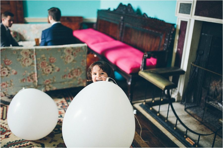 Cute little wedding guests playing with the balloons!