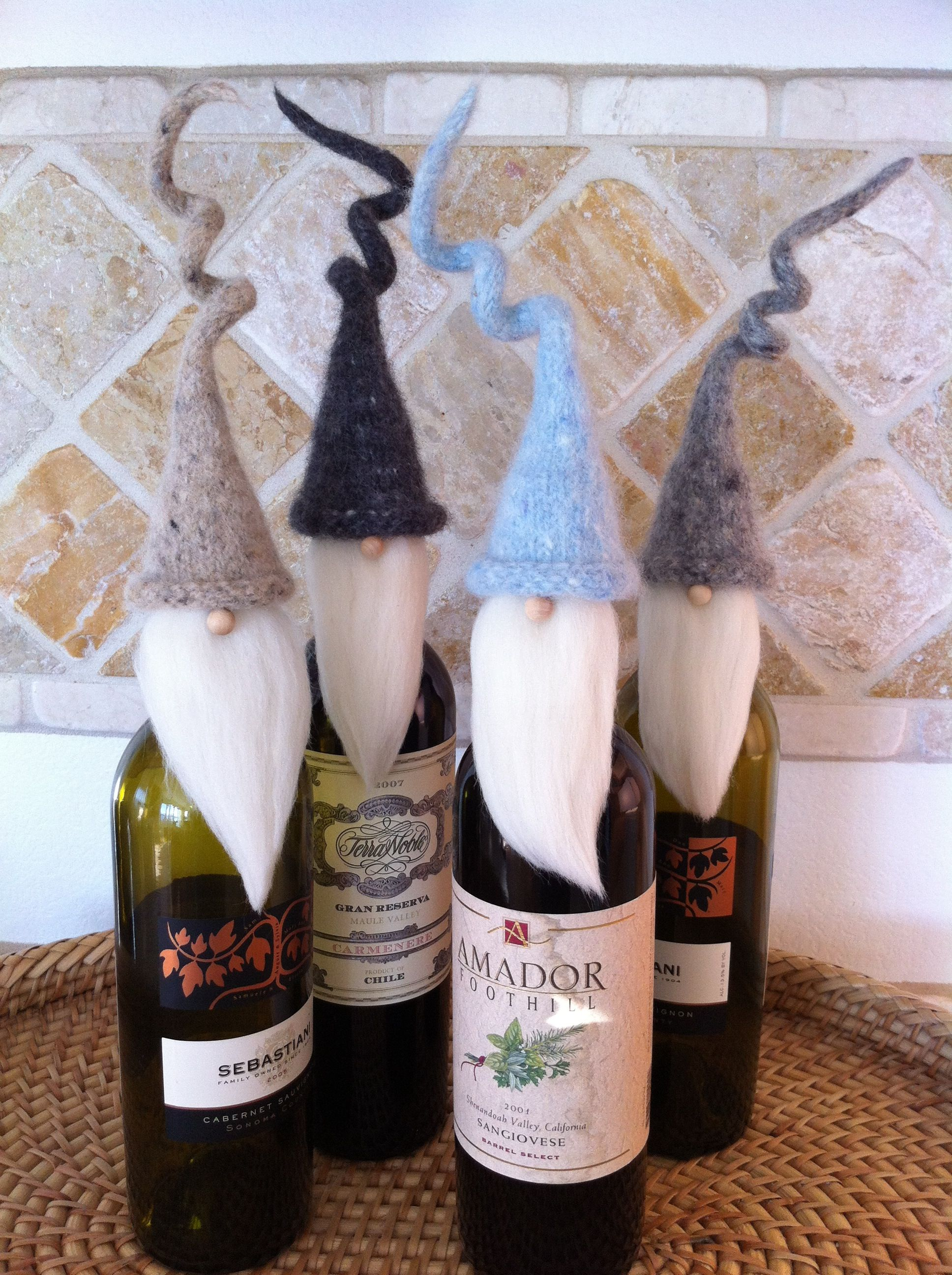 Knitted wine bottle toppers, perfect to bring to a holiday party ...