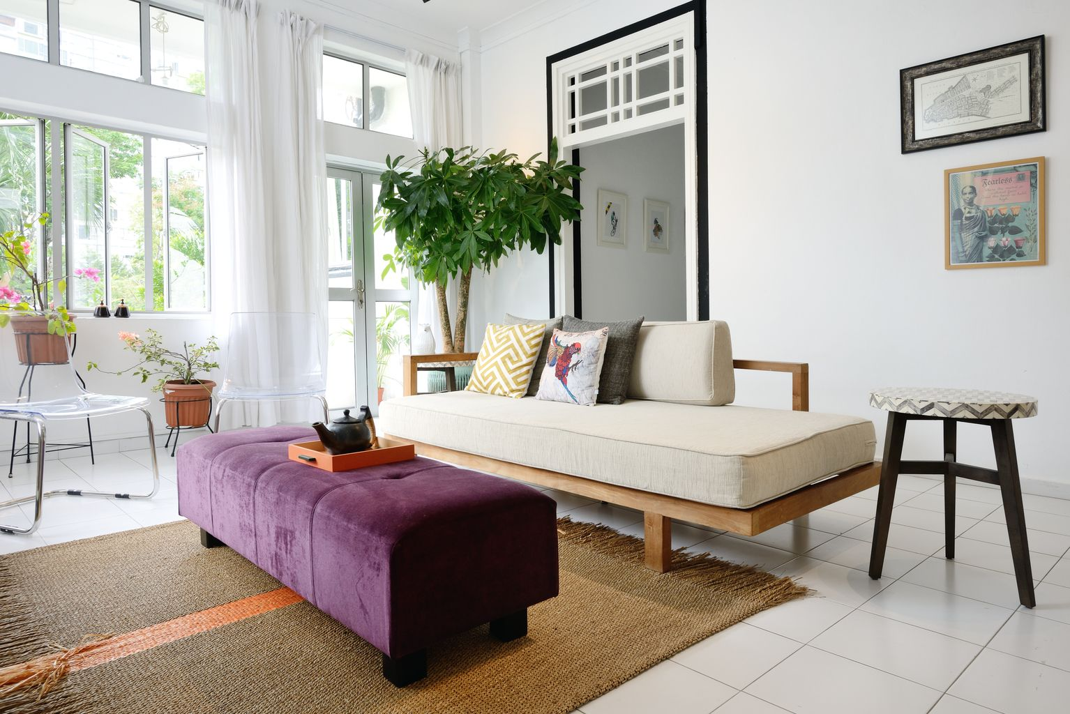 The focal point of the living room is a daybed made in teak wood ...