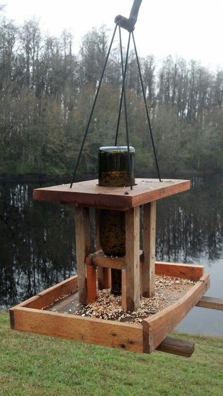 wine bottle bird feeder made out of left over pallet wood