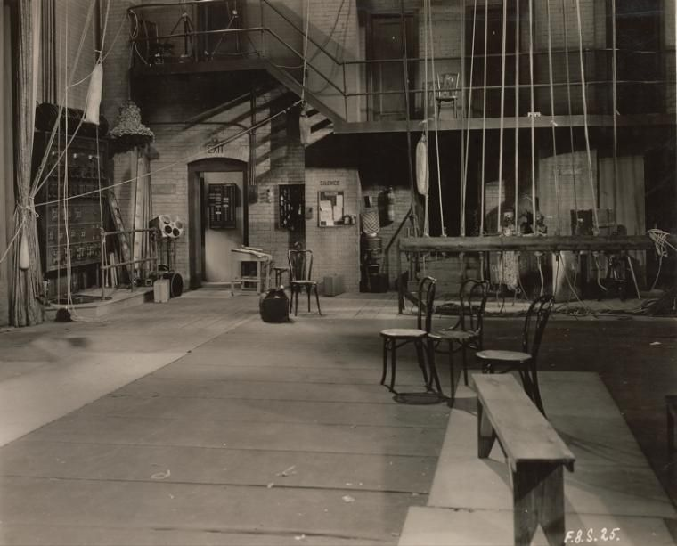 Theatres--  Backstage. (Stage with chairs and bench in foreground.)