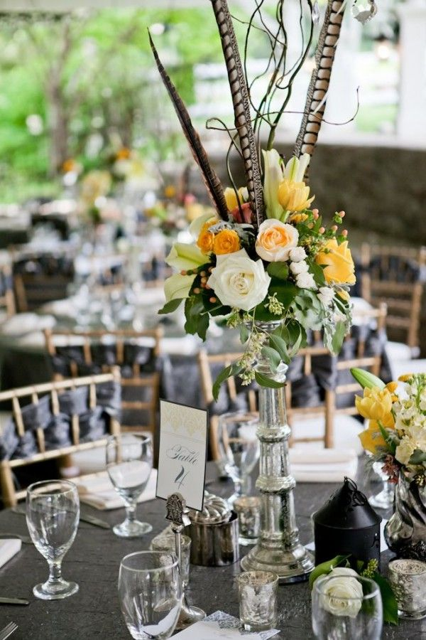 Tall wedding centerpiece with pheasant feathers