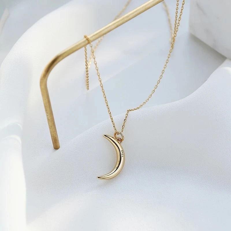 Photo of Golden Crescent Moon Necklace