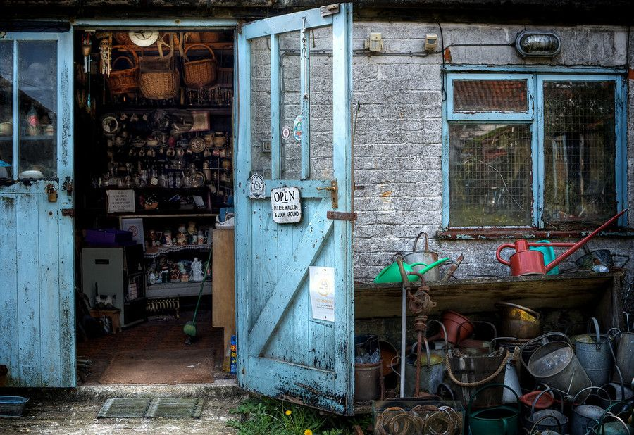Josie's junk shop in Bempton feels like stepping through a time machine into a mish mash of eras past. Rusty watering cans stacked outside frame the entrance to a timeless cove of possessions. ©Ryan Learoyd All Rights Reserved
