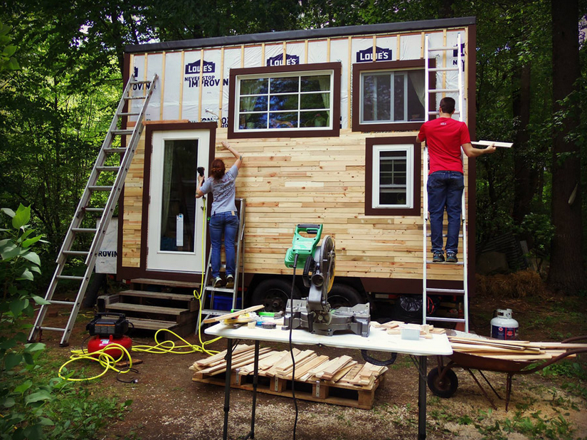 Build your own tiny house on wheels small pieces of wood are arranged neatly into the