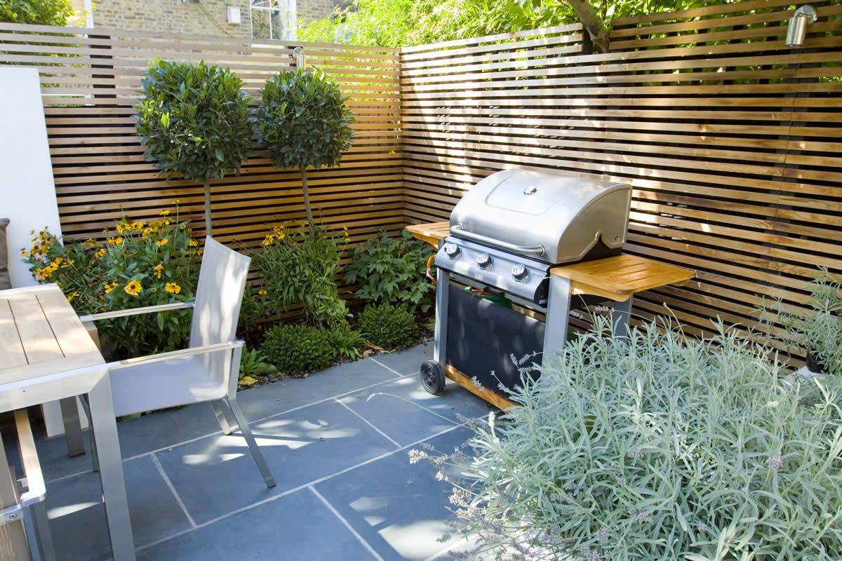 Brilliant small garden ideas with outdoor dining space and barbeque set on grey home garden - Small garden space ideas property ...