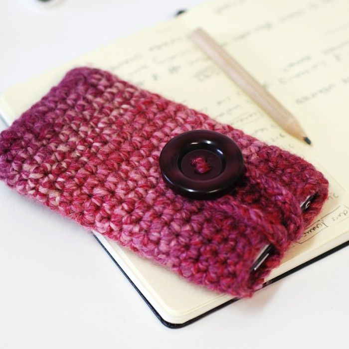 Multicoloured pink iPhone case with large button
