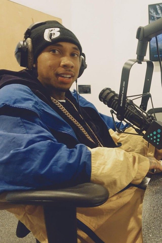 Tyga wearing  Tommy Hilfiger Vintage Windbreaker Jacket, Supreme Ruff Ryders Beanie