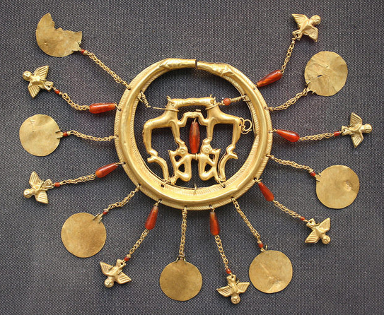 The Largest Extant Minoan Gold Earring, C. 1850-1550 BCFrom the Aigina Treasure, decorated with hounds, monkeys, birds and carnelian