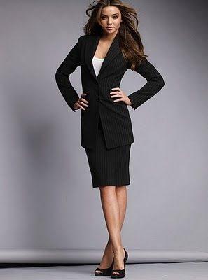 semi formal professional / business attire at the office, bodysuit, shirt, skirt and more (for women). Like the outfit but the jacket is too long. Too early 90's.