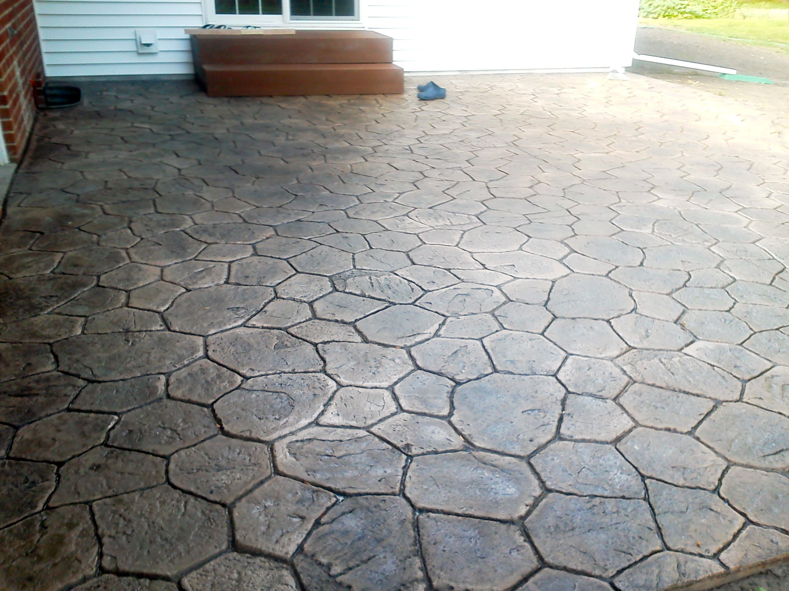 Stamped Concrete Patio Pattern is Random Stone Colors are Thyme