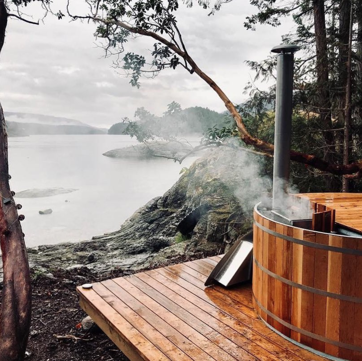Wood Fired Cedar Hot Tubs Made In Canada Thoughtfully Designed Handcrafted And Quality Tested Uniquely Made To Guaran Cedar Hot Tub Hot Tub Outdoor Hot Tub