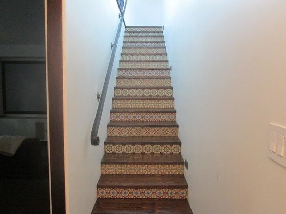 mexican pavers and talavera tile with wood stairs ...