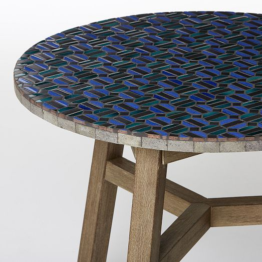 So glad they brought this back. Now I can go another round mentally wrestling with the urge to purchase it. Harrumph! {{Mosaic Tiled Bistro Table - Indigo Hex + Driftwood Base | West Elm}}