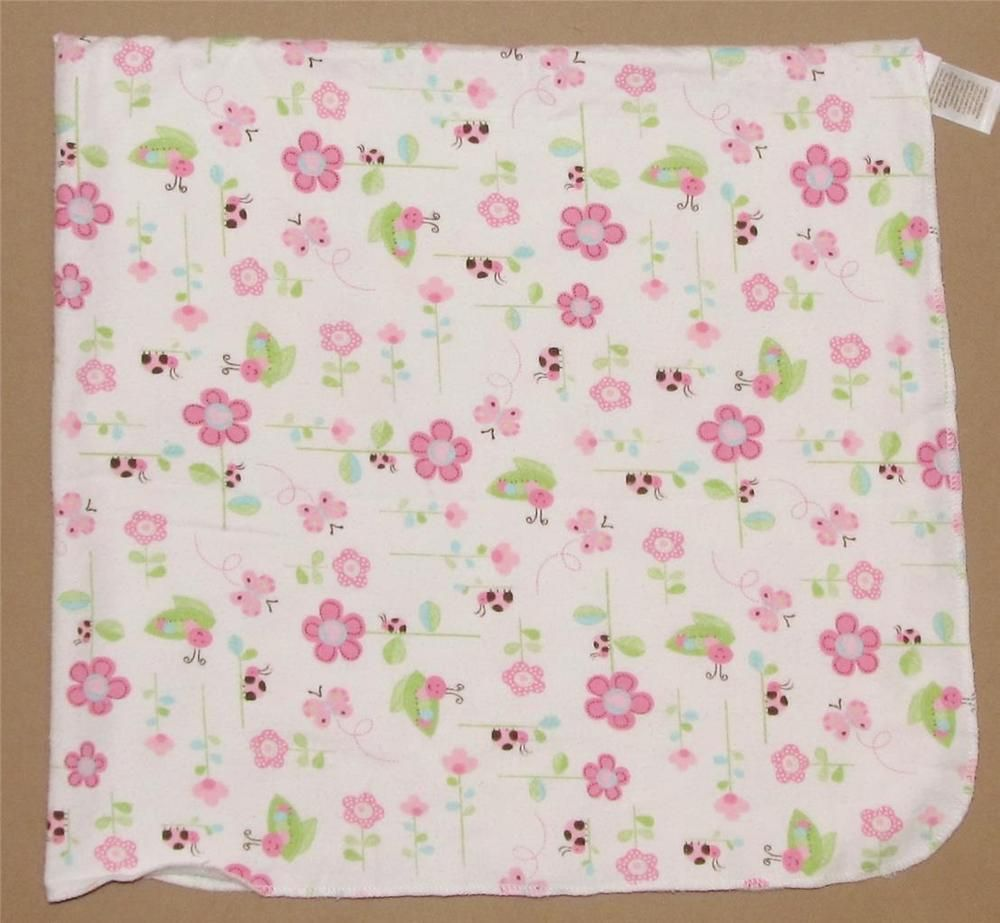cream pram blanket with colourful butterfly