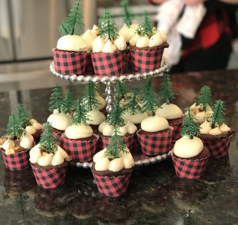 Buffalo Plaid Cupcake Wrappers With Evergreen Tree Toppers For A Lumberjack Birthday Party