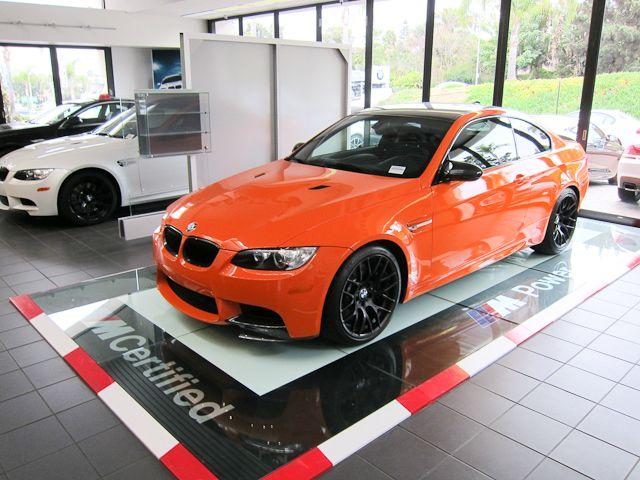 Orange M3 Black Wheels Black Roof Black Spoiler.