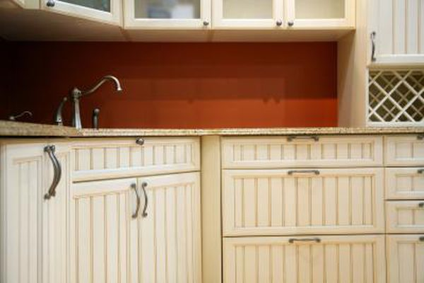 How to Glaze Over Polyurethane on Cabinets - Beadboard kitchen cabinets, Beadboard kitchen, Beadboard, Cabinet doors, Whitewash kitchen cabinets, Paint cabinets white - A dated cabinet finish gives a kitchen a retro look, though not always in a good way  You can change the tone of your cabinets  without the hassle of stripping and restaining  by glazing right over their existing polyurethane finish  A glaze is essentially a clear finish with added pigment that renders it